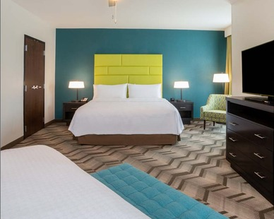 Homewood hotel suites are spacious and have a contemporary design with eye-catching elements.