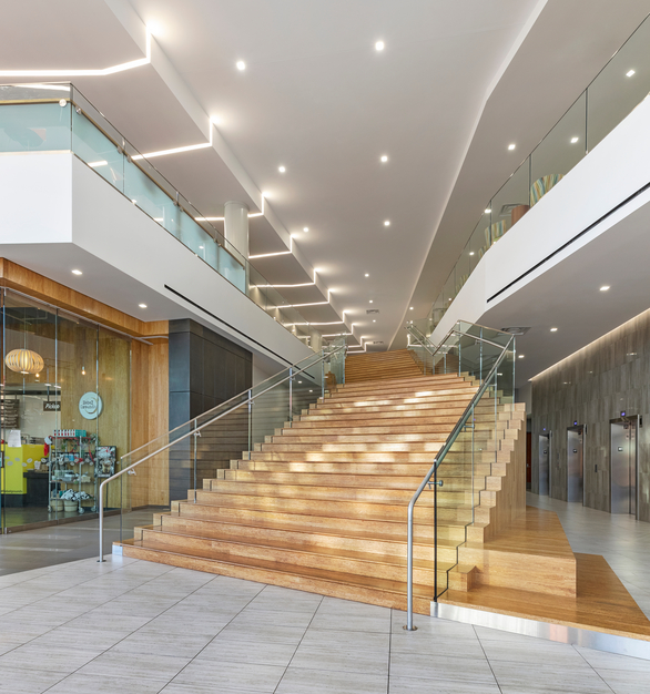 Expansive lobby and stairway at the Hospitality Hall of William F. Harrah College of Hospitality with the stunning ceiling by Fellert and their Even Better Silk system.