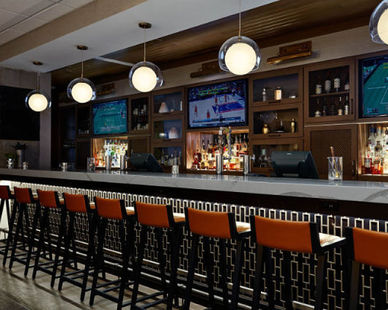 Gorgeous hotel bar space created featuring St. Germain's Cabinet's work