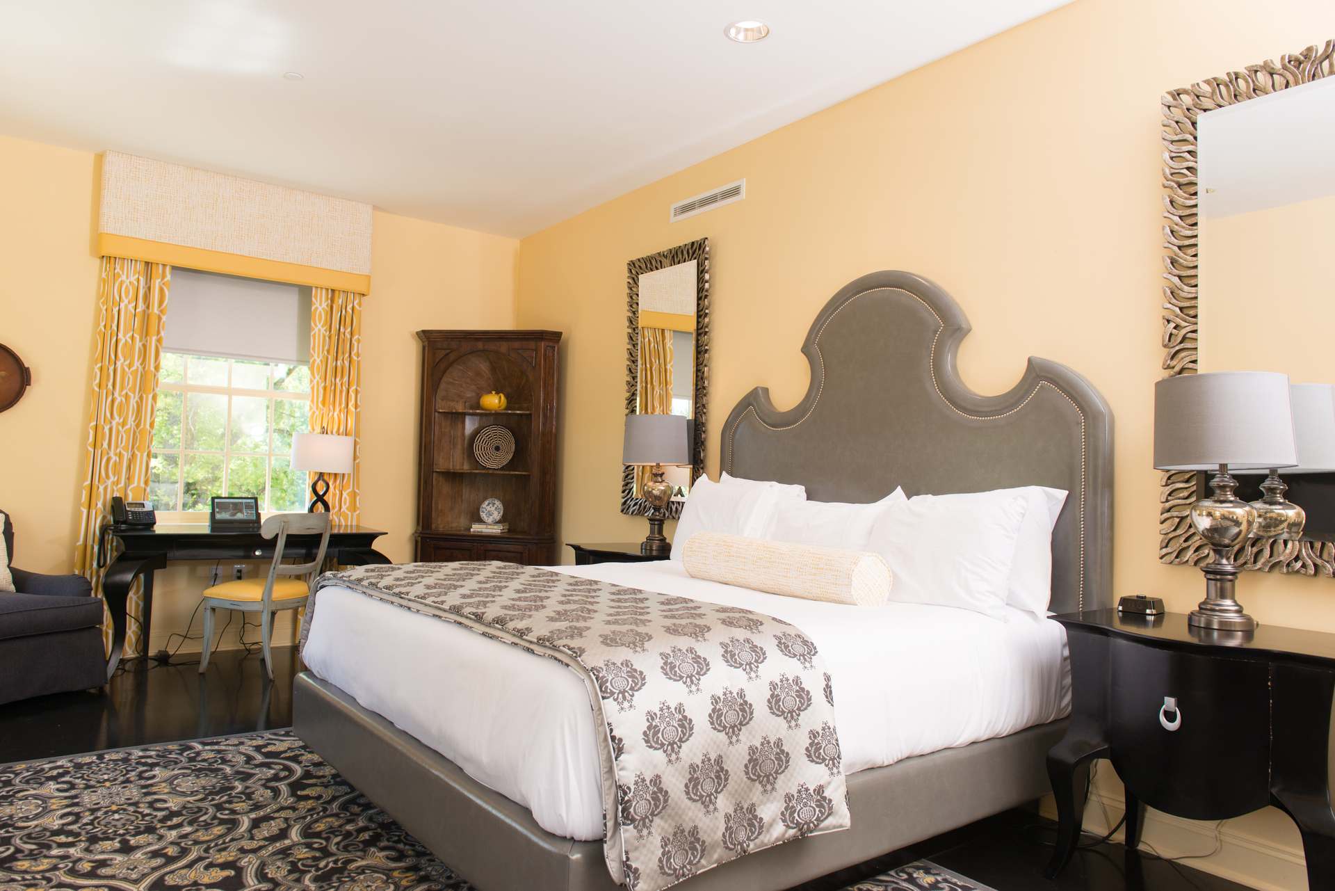 This beautifully decorated butter yellow hotel room is the perfect spot to relax and enjoy your vacation.  These rooms all have sound-reducing drywall to create a serene and relaxing room for all guests.