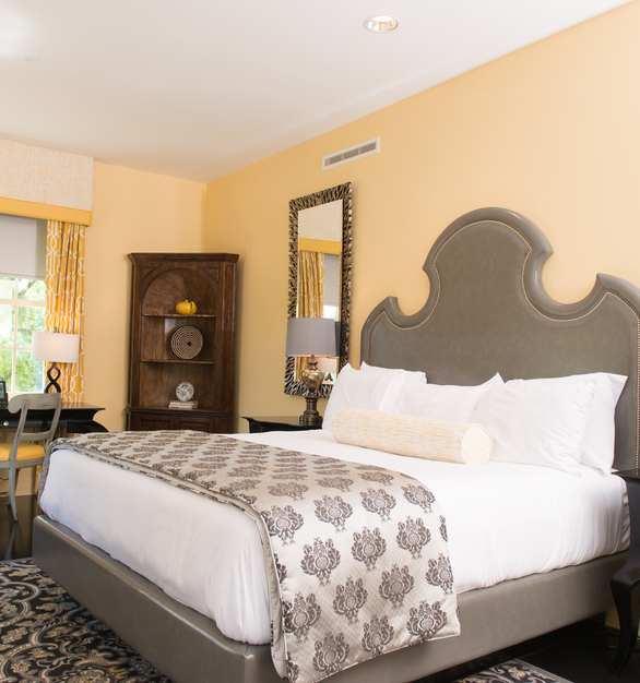 This beautifully decorated butter yellow hotel room is the perfect spot to relax and enjoy your vacation.