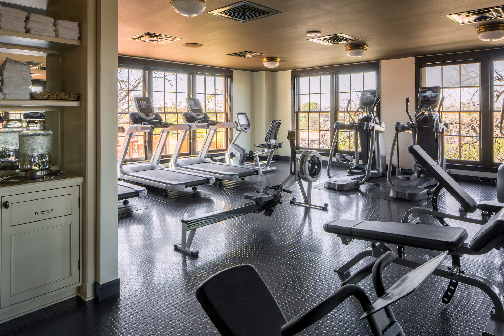 The airy and open-like fitness center at Hotel Emma in San Antonio, TX, featuring double-hung window systems by Pella.