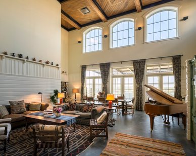 Expansive windows by Pella allow natural light to fill a common room at Hotel Emma in San Antonio, TX.