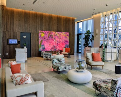 Walk in and admire this cozy and eclectic lobby at the Dalmar Hotel.  They worked with Surfacing Solutions to use their solid wood paneling for their accent wall to show off the large wall art.