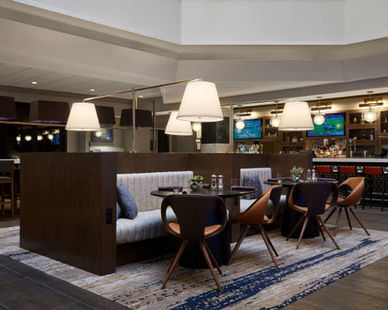 A hotel lounge area with work completed by St. Germain's Cabinet work.