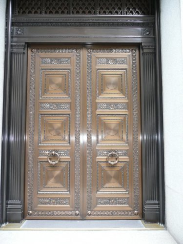 Grand entrance to Hotel Peninsula in Tokyo, Japan. This door was produced by Astec using ABX Architectural Bronze. Astec-USA is based in Brooklyn, New York.