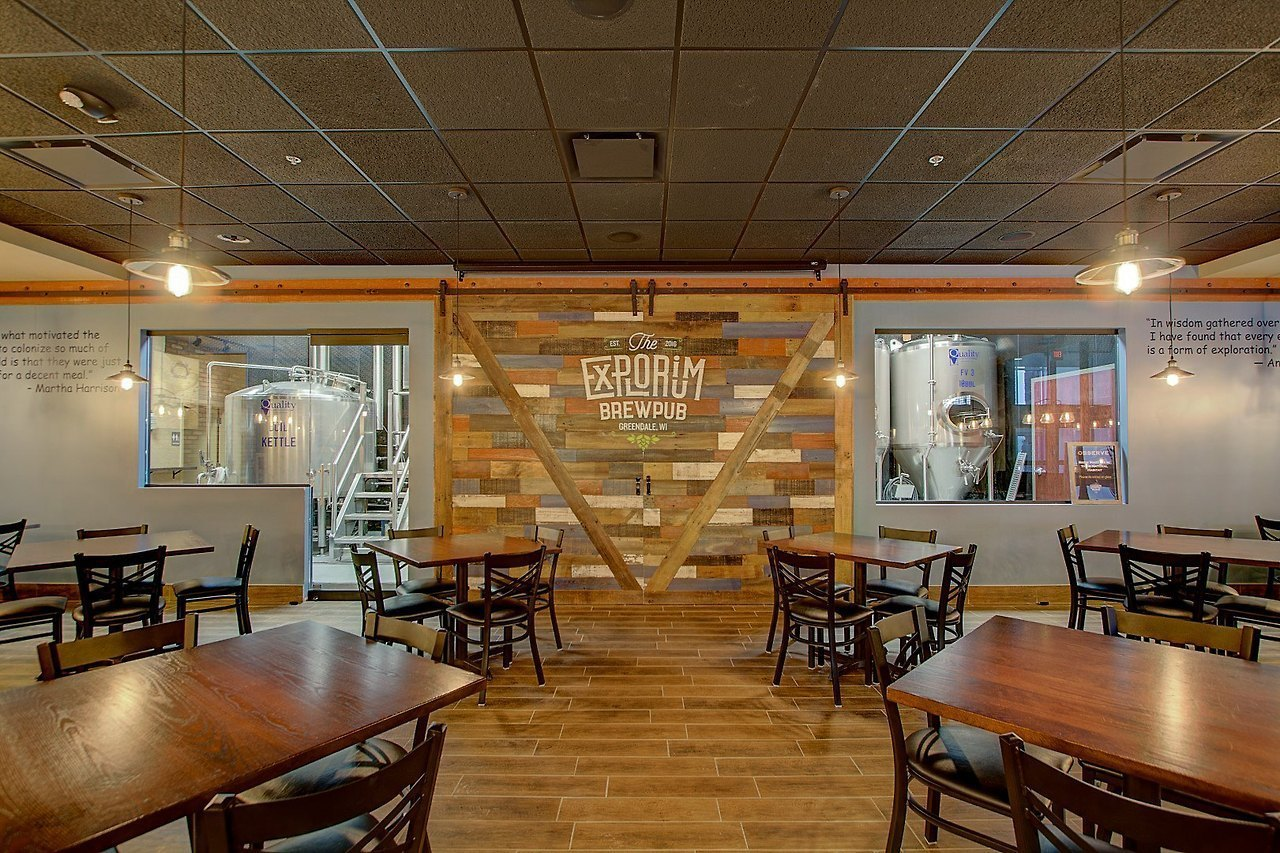 A modern twist on the large barn door done by i2i Designs at The Explorium Brewpub in Greendale, WI.