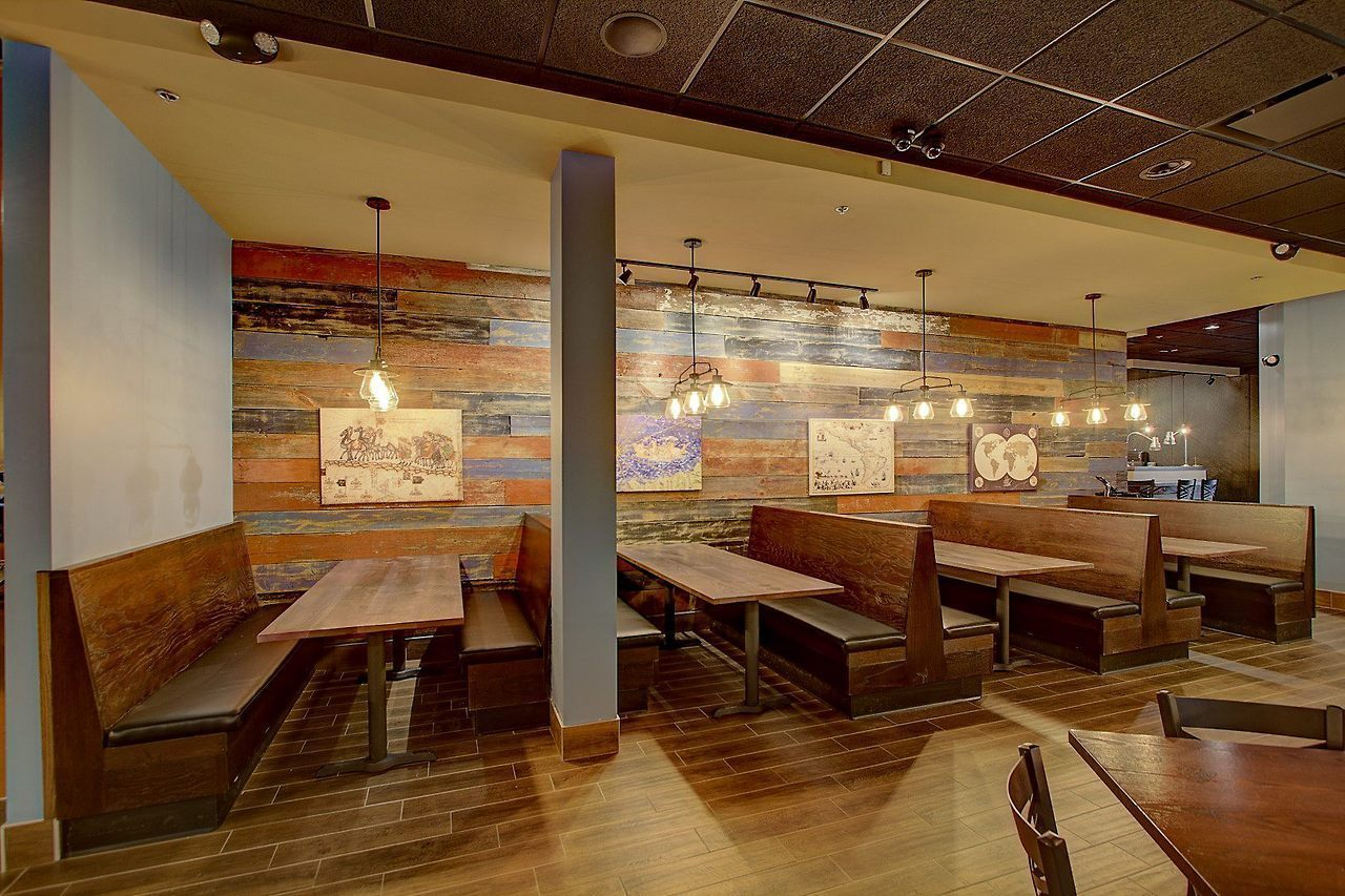 Wall cladding, booths, and tables done by i2i Designs at The Explorium Brewpub in Greendale, WI.
