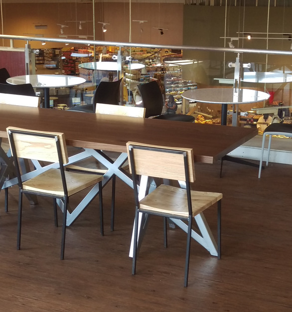 "i2i Design built custom walnut community sized table top with weathered grey stain and chrome powder coated steel ""crazy leg"" base for a Mariano's grocery store."