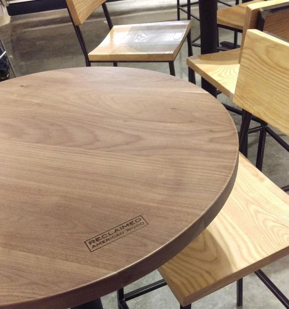 i2i Design customized these round café tables in walnut with weathered grey stain for the Mariano's grocery store dinning area.