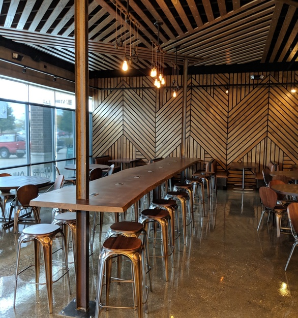 Beautiful wall cladding, ceiling elements, and tables at MA Burger, by i2i Design
