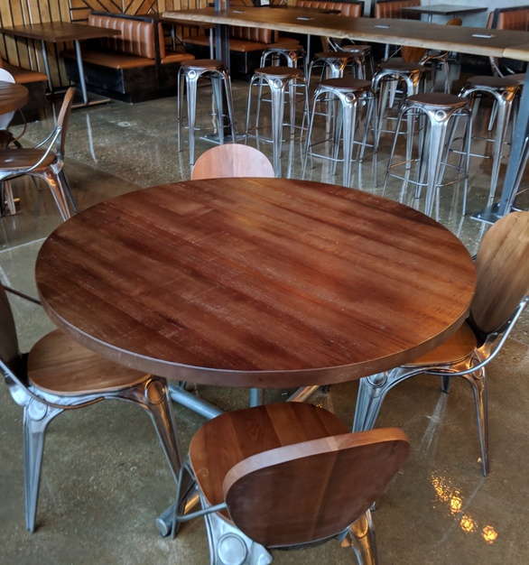 This distressed Oak tabletop by i2i Deisgn will stand up to the rigors of a busy restaurant.