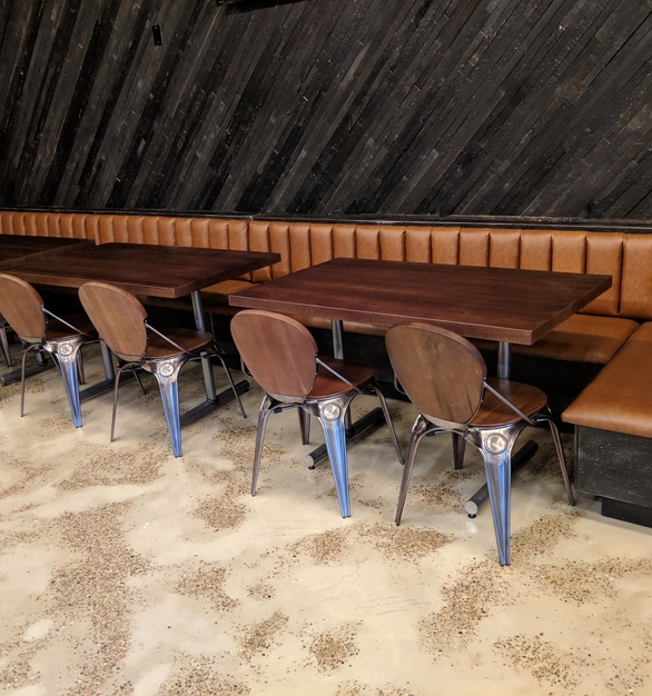 Wall cladding and tables all done with reclaimed wood, by i2i Design