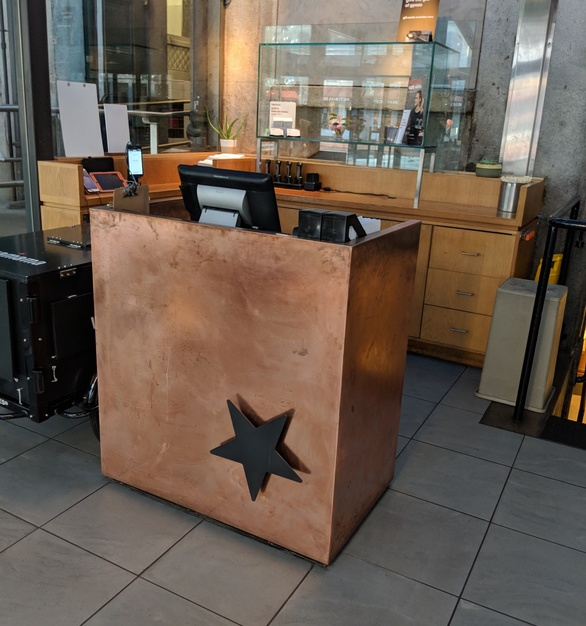 A Custom copper host stand to incorporate a blackened steel star logo.