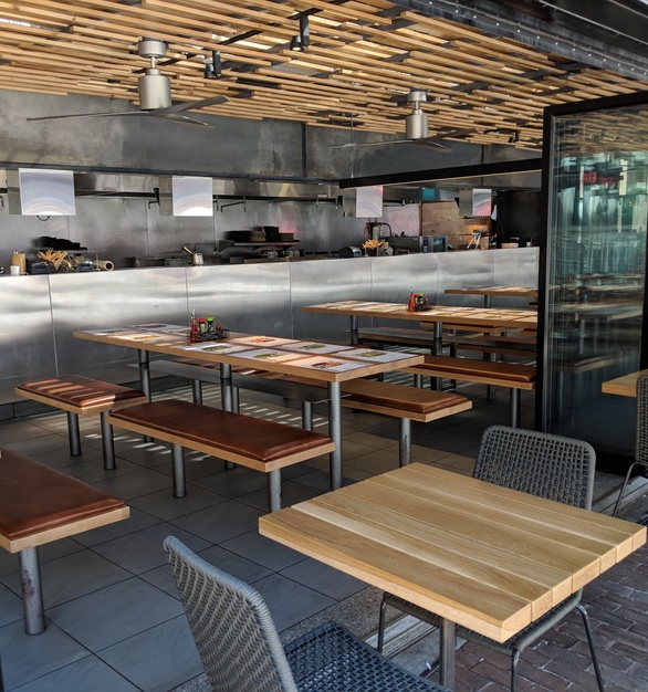 What a fun setting for indoor or outdoor dining. Wood tables, benches, bases and ceiling made by i2i Design.