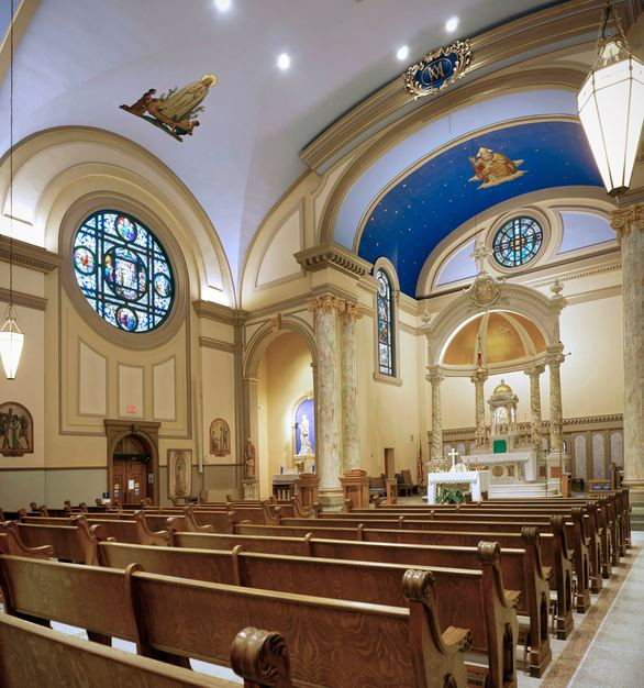 The beautifully lit Sanctuary at Immaculate Conception in Charles City, Iowa, by JTH Lighting Alliance.