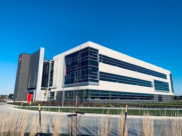 Southeast exterior view showing FormanFord unitized curtainwall, ACM panels, and aluminum screen wall.