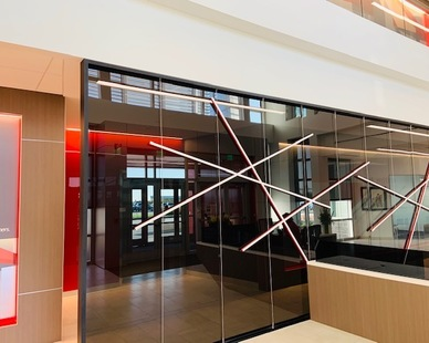 Tinted laminated glass with cable suspended aluminum artwork fabricated and installed by FormanFord.