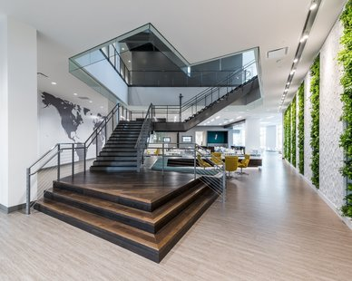 With horizontal space at a premium in an office space, Natura has taken plants up the walls to bring the benefits of nature to commercial environments, both inside and out.