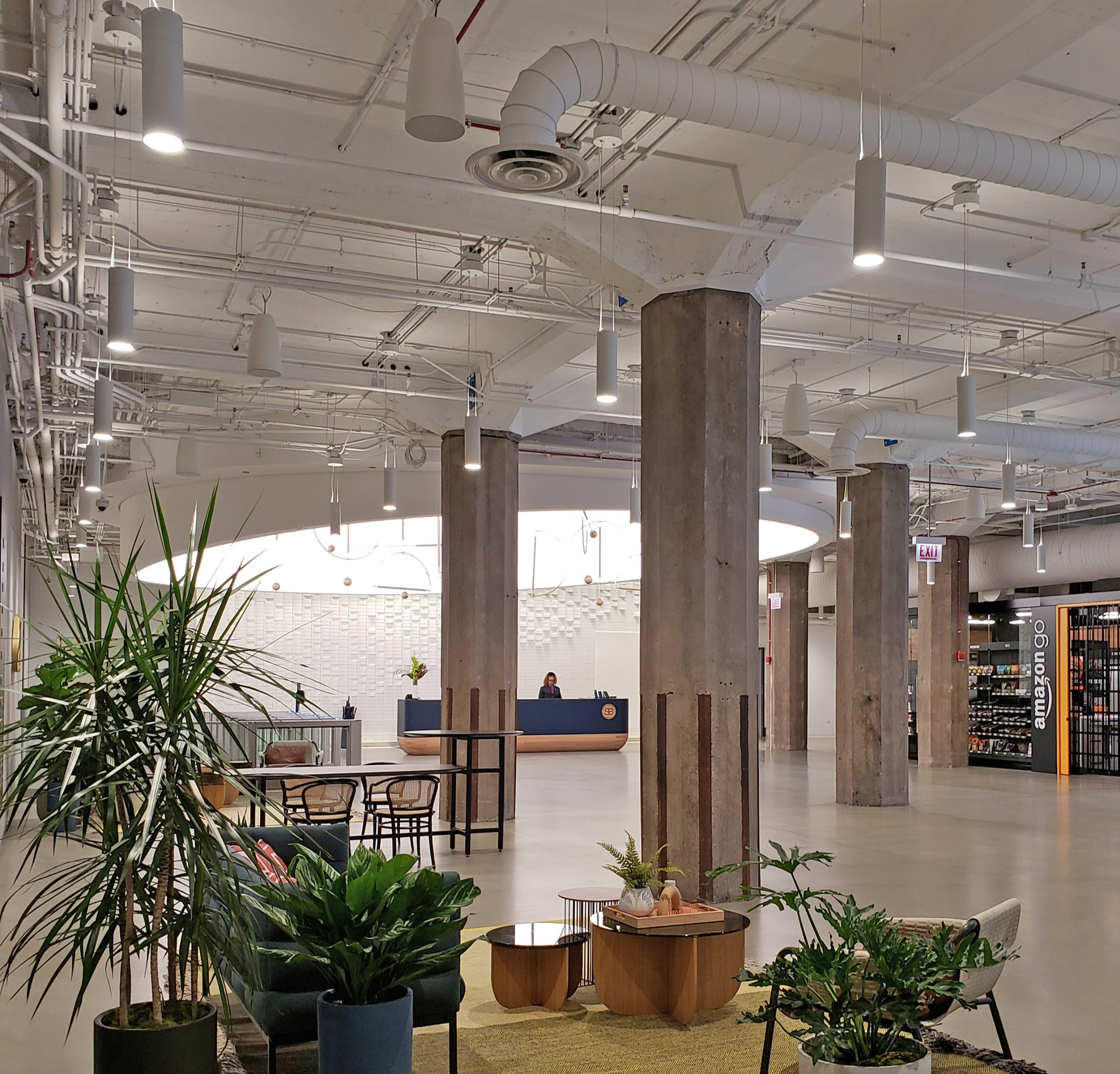 Enjoy the natural light in the waiting area of this historic office building.  The stone pillars and the exposed ceiling add to the mid-century industrial design.