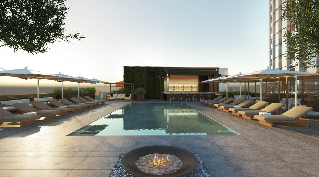 Beautiful exterior hotel pool showcasing almost hidden drains provided by Infinity Drain.