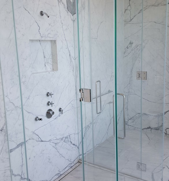 Marble shower design with luxury shower drains provided by Infinity Drain.