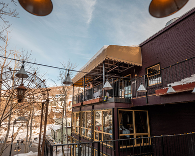 The exterior view and window design of the Grappa Restaurant. Their outdoor patio dining features our SL-Series outdoor heaters to provide comfort for guests and visitors.