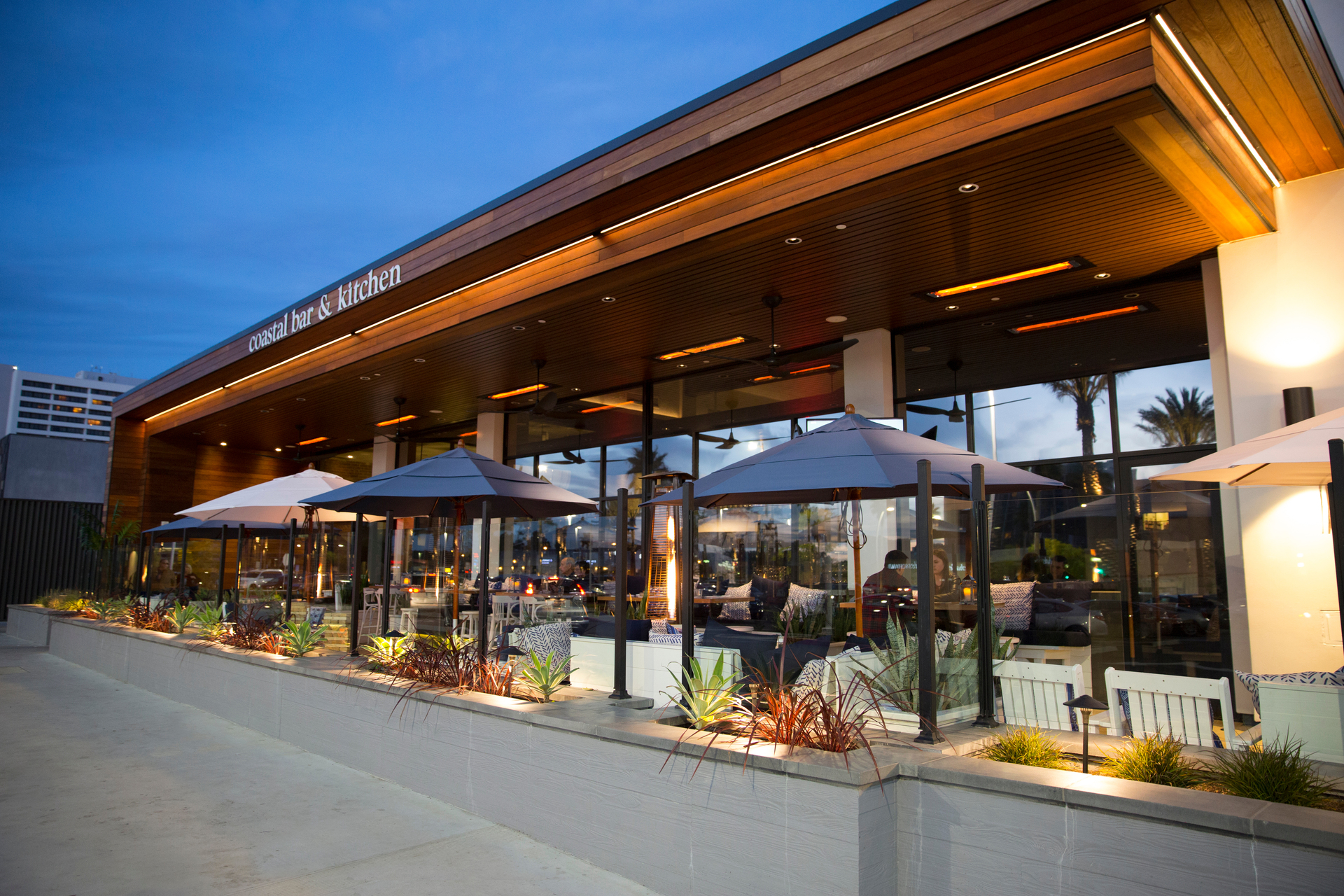 The outdoor eating spaces at Brio Coastal Bar features our WD-Series dual element heaters for their outstanding performance and modern look. WD-Series heaters are available in a range of colors, to coordinate with your interior or exterior environment. Choose from brushed stainless steel or eight standard color finish options.