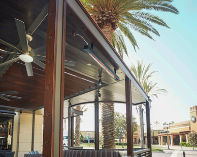 Slimline Infratech heaters installed to the ceiling of the restaurant outdoor seating space.