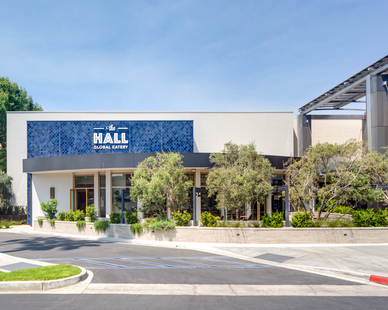The exterior design of Hall Global Eatery in Costa Mesa, CA. We provided our premium infrared outdoor heaters for their patio dining areas because of their low-profile design and unique functionality.
