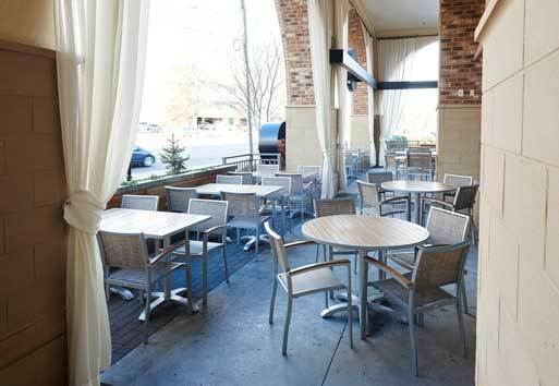 The goal for Brixx restaurant was to soften the hard brick exterior by installing six oversized fabric panels that complement the archways and draw attention to the outdoor dining space. Inpro Corporation used the Hinkel brand for drapes.