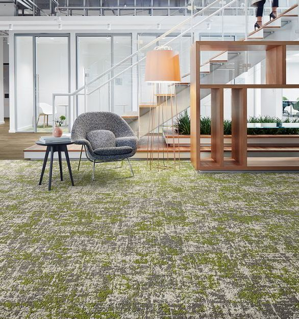 Interface's Simple Abstraction Collection Painted Gesture 105974 Urban carpet tile in a mid-century modern work lounge setting.