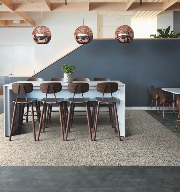 Interface's Visual Code Collection Haptic 105956 B&W Haptic carpet tile in a modern break room setting.