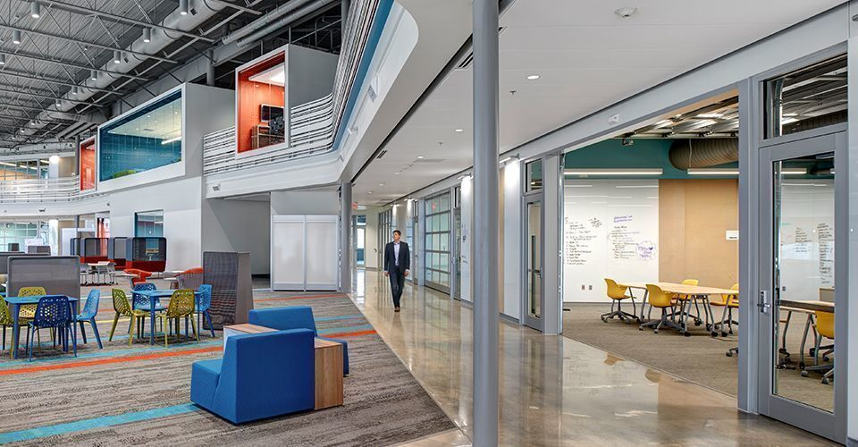 Large commons area at the Waukee Innovation and Learning Center in Waukee, Iowa, features Interface carpet tiles.