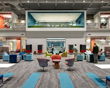 The expansive commons area at the Waukee Innovation and Learning Center in Waukee, Iowa, features carpet tiles from Interface's Human Nature Collection.