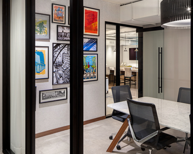 Conference room designed by InUnison Design showcasing an eclectic collection of artwork to bring life to the space.
