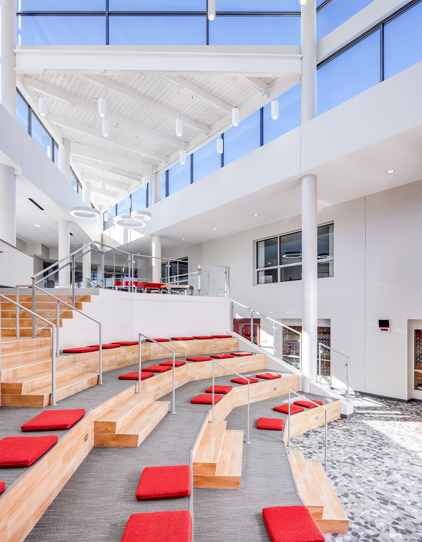 Light-filled atrium addition where students, teachers, and visitors activate into vital educational space.