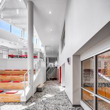 inunison-design-benilde-st-margaret-addition-atrium-lower-level-classrooms