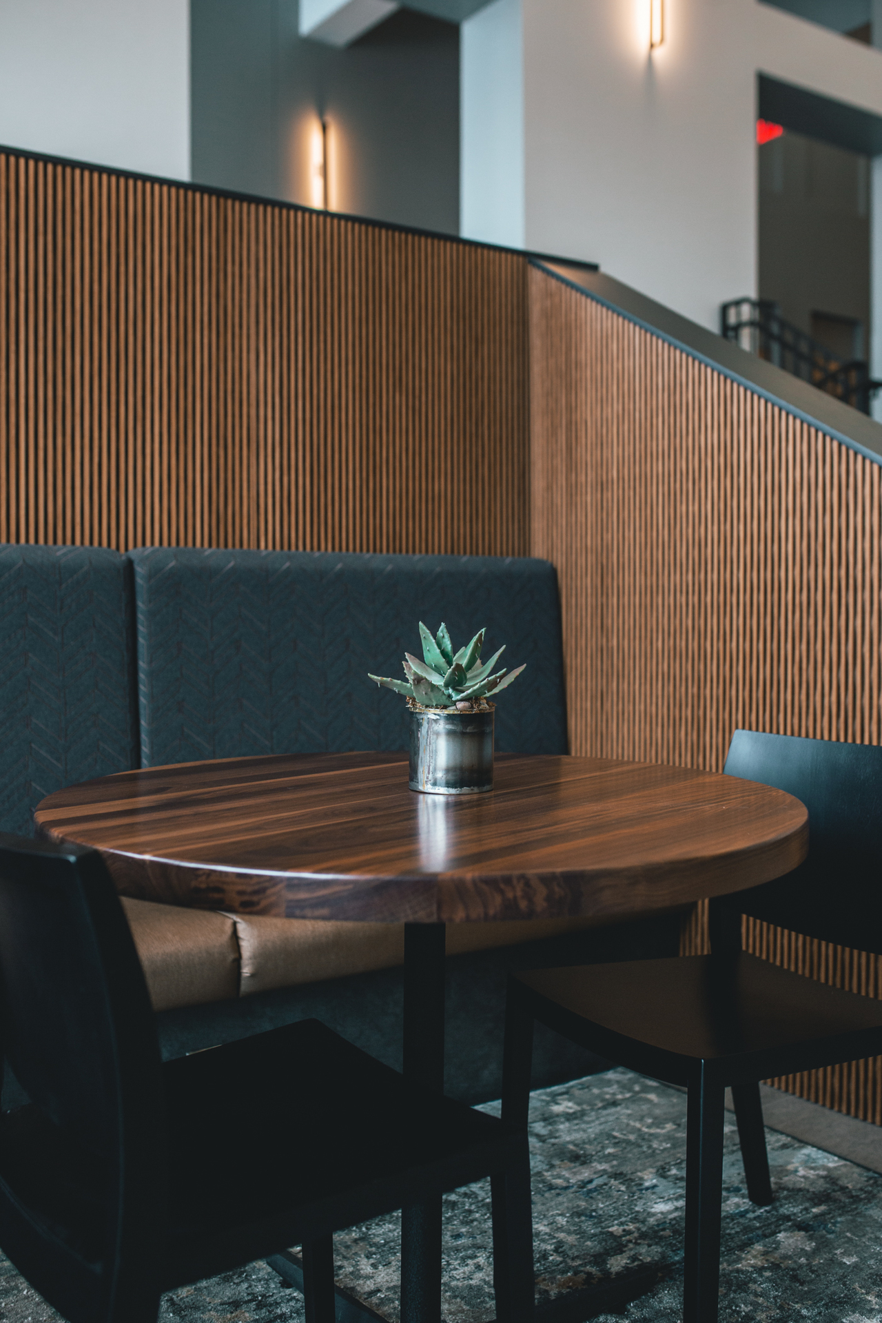 Tables are includes with booth seating and custom chairs to bring the space together.