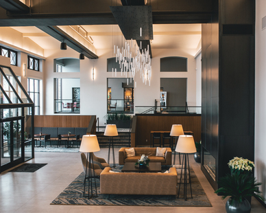 IMS gives a loft vibe and the mix of stunning light fixutres and natural colors perfects the space.