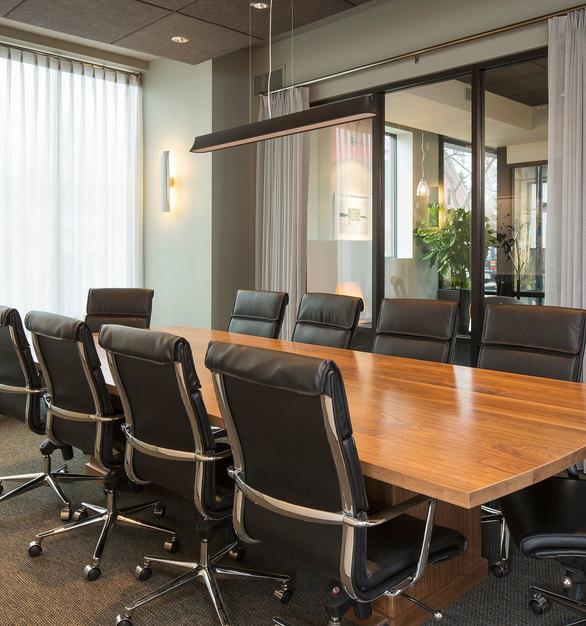 Sleek Meeting/Conference room designed by InUnison Design.