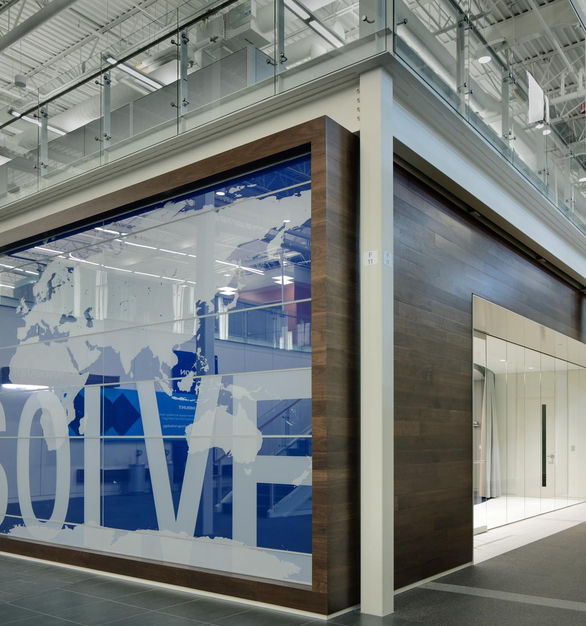 The beautiful glass feature wall at Emerson designed by InVision Glass Design.
