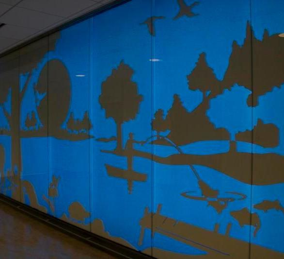 Glowing 30 foot walls create a colorful design that engages all that walk by at the University of Minnesota Children's Hospital in Minneapolis, Minnesota, by Invision Glass Design.