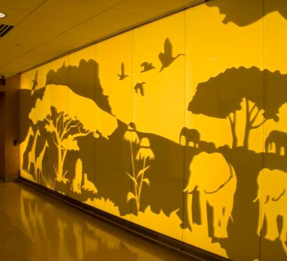 Passport to Discovery theme is brought out in its true form with the Feature Walls created on every floor. IGD Infused the color onto the glass and finished the 2nd surface with translucent powder coat to allow for back lighting the wall. This project was completed at the University of Minnesota Children's Hospital in Minneapolis, Minnesota, by InVision Glass Design.