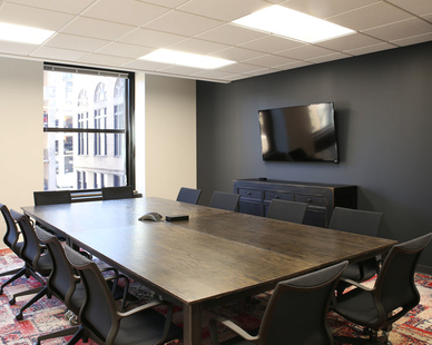 The conference room provides a warm and inviting atmosphere at COCO in Minneapolis, Minnesota, furnished by iSpace Environments.