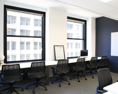 Oversized windows makes a space inviting to encourage productivity and collaboration at COCO in Minneapolis, Minnesota, furnished by iSpace Environments.