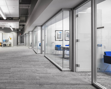 Glass walls open up to office space, but also provide private areas for important conversations.