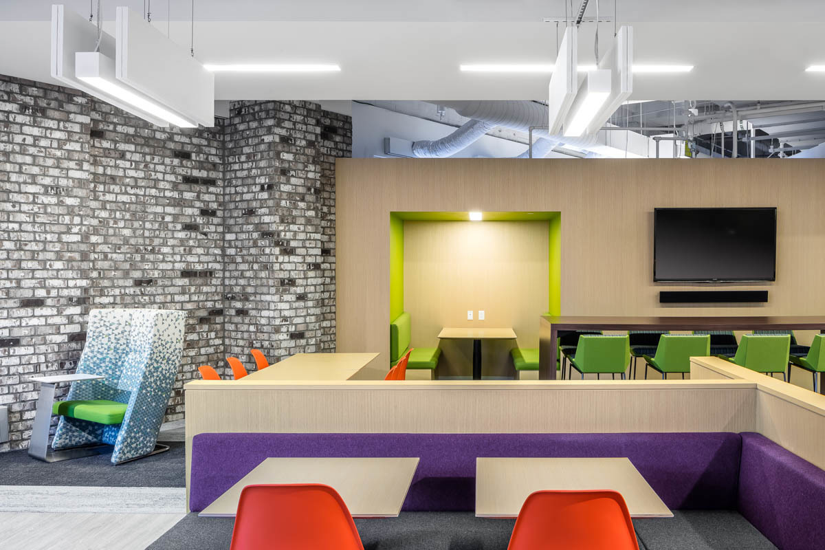 The employee common area at Fish & Richardson offers a variety of seating areas for co-workers to engage and collaborate with each other.