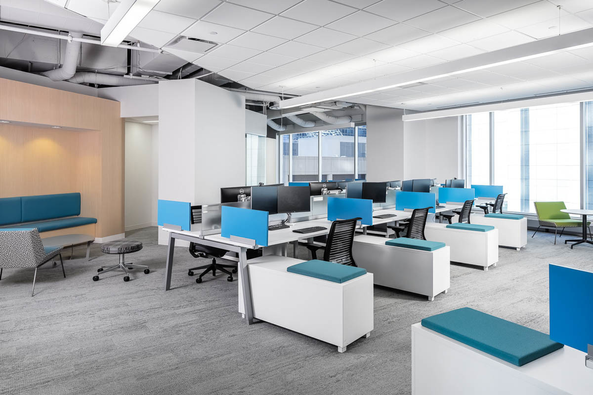 The open office cubicle designs match the overall company brand colors in the Fish & Richardson office in Minneapolis, Minnesota.