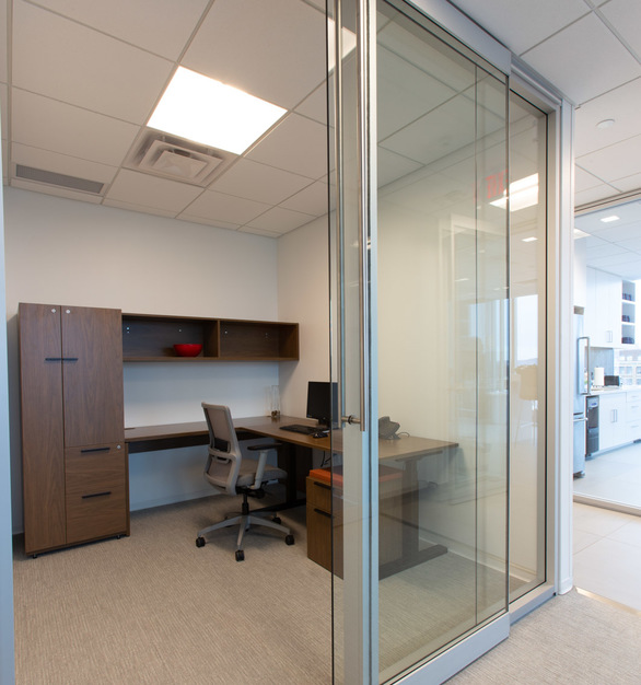 iSpace Environments was invited to collaborate with the architects and designers at NELSON to outfit nearly every inch of Gislason & Hunter's floorplate. As a legal firm, privacy was crucial, so the design called for private offices exclusively, rather than open workspaces. Glass-clad Teknion Optos architectural walls mirror the aesthetic of the floor-to-ceiling glass of the building architecture and ensure ample light to the innermost spaces while ensuring acoustic division.